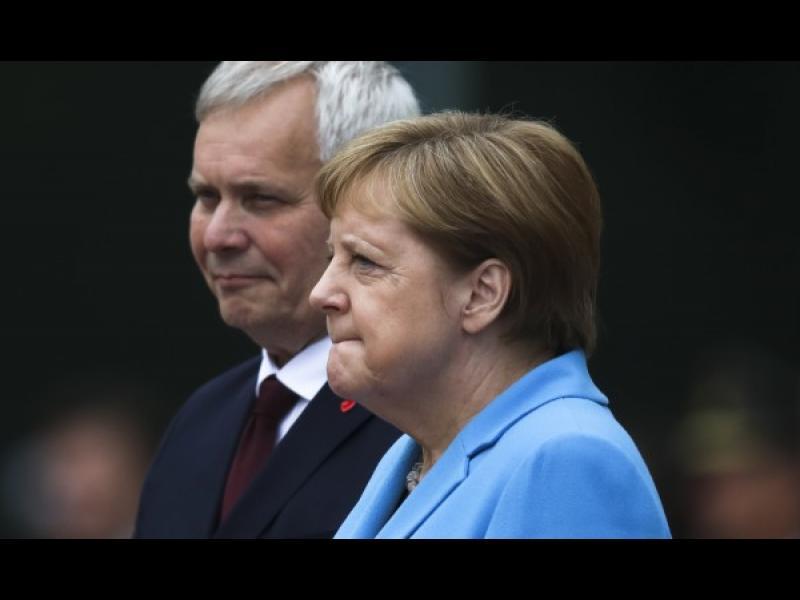 На какво може да се дължи треперенето на Меркел?